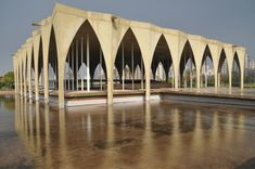 International Fair of Tripoli by Oscar Niemeyer: Modern Lebanese building - design by Modernist Brazilian architect - Tripoli fairgrounds by Oscar Niemeyer Oscar Niemeyer, Arch Building, Building Design, Ludwig Mies Van Der Rohe, Brick, Columns, Modern, Architectural Drawings, Mosque