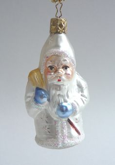 "Snowflake Santa Glass Ornament. Inge Glas ornaments are created from new and antique molds.  Mouth Blown and Hand-Painted.  4"" from tip of cap to bottom of ornament. Made in Neustadt, Germany. Santa brings unselfishness and goodwill.   Available at www.mygrowingtraditions.com"