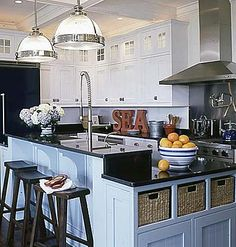 Blue coastal kitchen--love the two levels of the island, the baskets for storage, and the glass front cabinets at top--could be added to existing.
