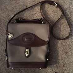 """Vintage Dooney & Bourke tan pebble EUC purse Authentic DB vintage early 90's tan pebble cross body bag with gold hardware. Footed bottom. Got it in 1995 & have only carried it a handful of times so it is in great condition. Just too small for me. Smoke free home. Gorgeous classic style!!  L: approx 8 1/2""""- 9 1/2"""" (tapers slightly out at top), H: 10"""", W: 2 1/2"""". Open to offers! Dooney & Bourke Bags"""
