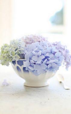 flower arrangement in an antique bowl