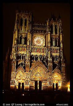 Cathedral facade laser-illuminated at night to recreate original colors, Amiens. France (color)