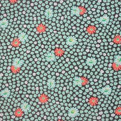 Mint Coral Daisy on Grey Cotton Jersey Blend Knit Fabric - Sweet big and small daisy floral print in colours of mint green and coral orange on a dark grey background cotton rayon jersey blend knit.  Fabric is soft, with a nice stretch and recovery, light to mid weight.  Biggest daisy measures 2.5cm.  ::  £9.95