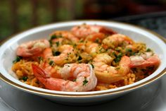 Arroz con camarones or shrimp rice is a traditional Latin dish made with rice cooked in a shrimp broth and sautéed with shrimp or prawns, onions, peppers, tomatoes, garlic, cumin, achiote and parsley.