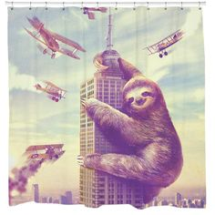 Slothzilla Shower Curtain. Wake up to the laziest attack ever! Need a funny shower curtain? Look no further than Sharp Shirter's Slothzilla! This cool shower curtain design will bring life to any bathroom. There's no better way to start your morning than with laughter. Slothzilla shower curtain does just the thing!