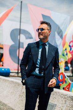 See the best looks from Pitti Uomo Menswear Week Spring/Summer 2017 spotted outside the shows. Captured by Jonathan Daniel Pryce.