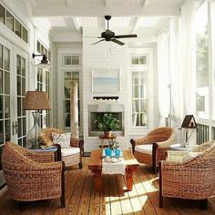 Love the natural texture of the chairs in this sunroom.