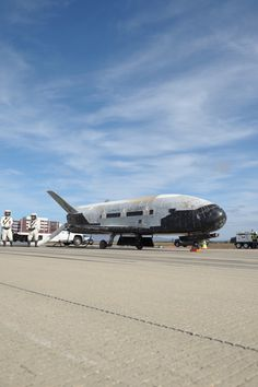The U.S. Air Force landed its mysterious X-37B space plane at Vandenberg Air Force Base in California on Oct. 17, 2014. See the landing photos here.