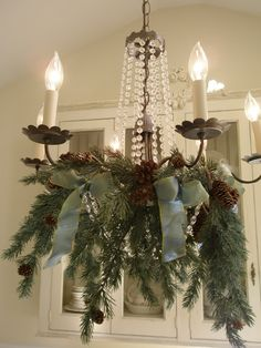 greenery and pine cones chandelier