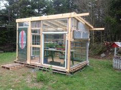 Image result for greenhouse from pallets and old windows