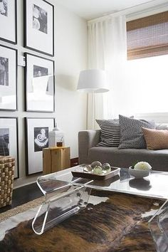 Great Virginia Macdonald Photography   HGTVu0027s Pure Design   Black And White Photo  Wall Gallery, Baskets, Acrylic Coffee Table, Sisal Rug And Cowhide Rug.