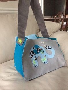 Felt baby bag with removable strap