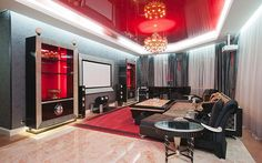 Red lacquer stretch ceiling in a living room.