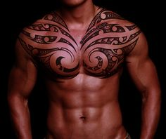 Tribal Tattoos | Curvy tribal tattoo on chest and shoulders - Tattoo Mania