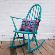 I have a little painted Ercol rocker like this one - would look fab with the green sofa in the Garden Room.