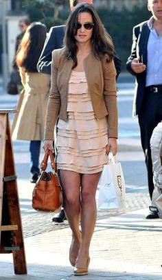Nude Mood  In a French Connection Pennys Party Silk Dress, a tan jacket by Whistles and Russell and Bromley heels in London on September 28.