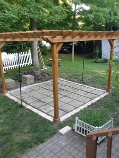 Adding patio stones under a pergola is a bit cheaper than the flagstone if your on a tighter budget.i used 2 different kinds for it,and will add pea gravel with gator dust locking sand to finish it. Pergola Canopy, Pergola Shade, Pergola Patio, Pergola Plans, Backyard Patio, Backyard Landscaping, Stone Backyard, Backyard Shade, Pea Gravel Patio