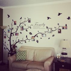 "Tree decal. I wanna do a family tree on the nursery wall with baby pictures of all ""bob's"" relatives similar to this."