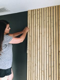 Learn how to create a wood slat wall in your home. Check out this DIY project! Wood Slat Ceiling, Wood Slat Wall, Wooden Slats, Timber Slats, Timber Cladding, Wood Walls, Interior Cladding, Interior Wood Paneling, Modern Wall Paneling