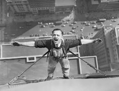 Air like wine. An unusual picture of one of the intrepid window washers working on the Empire State Building, as he pauses in his task to draw a lung-full of clean air at his height. May 24, 1936