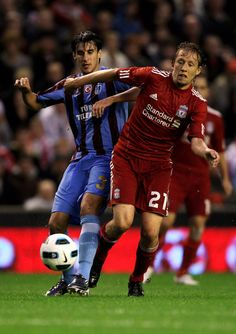 Lucas of Liverpool battles with Hrvoje Cale of Trabzonspor during the UEFA Europa League play-off first leg match beteween Liverpool and Trabzonspor at Anfield on August 19, 2010 in Liverpool, England. - 11 of 46