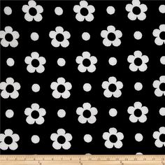 Pique Double Knit White Spring Flower on Black from @fabricdotcom  This unique double knit fabric features a pique texture on both sides. With just 10% stretch on the grain, this stable knit is perfect for dresses, skirts, and even unstructured jackets and blazers.