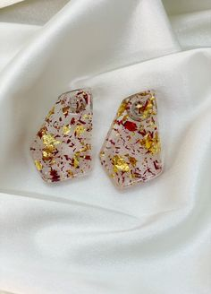 Currently obsessed with our Kesse pentagon stud earrings. These crystal clear beauties with flecks of yellow gold and red gold leaf make the earrings shine like sunrise. #handmadejewelry #flecksofgold #jewelryaddict #smallbusinesssupport #earringsoftheday #earringshandmade Earrings Handmade, Handmade Jewelry, Earring Crafts, Pentagon, Gold Leaf, Red Gold, African, Stud Earrings, Crystals