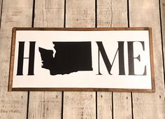 Hand painted wood sign, Home with Washington state This is a ready to ship item (1 available) *I can do any state. Just let me know which State you want in the comments *appx. 24 wide x 11 high *Handcrafted from a painted wood backing *Framed with stained wood trim *All lettering is hand painted, no vinyl on signs. If you would like a specific paint color for your lettering, please specify in your order. *It includes a hanger already installed on the back. *Top surface is sealed with a…