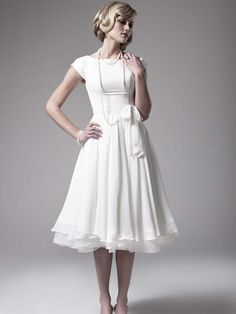 Love how simple and beautiful this is.... it would be best in something a little less white for me though. :-)