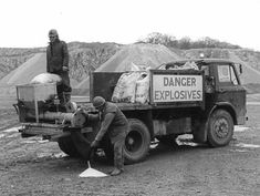 Filling a drill hole with ANFO explosive at Torr Works in the1970s.