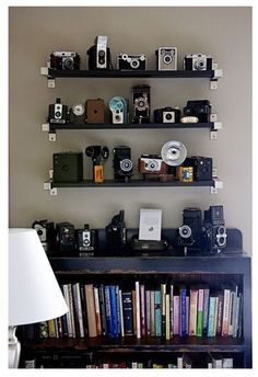 bookshelf décor to break up the flow of books - vintage camera collection