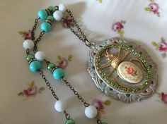 By Sarahs salvage shop on etsy   July challenge entry featuring a bug for this necklace