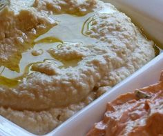 hummus~~Ina Garten's hummus recipe is creamy, delicious and easy-to-make. A drizzle of olive oil and a sprinkle of cumin make this appetizer complete.