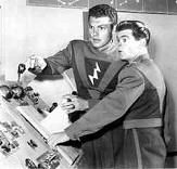 "Space Patrol (1950-55) $19.99; Commander Corey (Ed Kemmer) and youthful Cadet Happy (Lyn Osborn) roam the 30th century universe in their ship ""Terra"" fighting super-villains Mr. Proteus and Prince Baccarratti and other bad guys. Captured bad guys get zapped with the Paralyzer, then get reprogrammed with the Brainograph. Sold as a 2-DVD-R or VHS set."