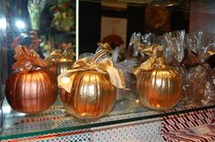 These are adorable! If you're feeling crafty, grab some gold and silver spray paint and a couple of pumpkins and gourds. A touch of ribbon and voila! Elegant table, shelf or mantle decor.