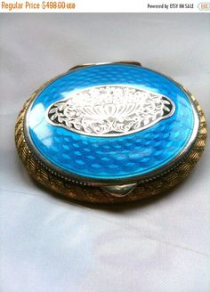 I acquired this beautiful Art Noveau silver and blue enamel compact at an antiques fair in the south of France last summer.  The craftsmanship is