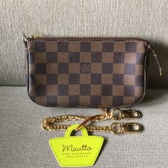 Louis Vuitton damier ebene pouch In great preloved condition, size is not quite as big as accessoires, and not small like mini pochette. Come with Mautto chain strap, since original strap is missing. Code:DU0078 thank you, but no trade. Louis Vuitton Bags Clutches & Wristlets