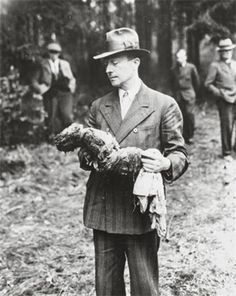 German man holding exhumed baby from a mass grave outside the town of Suttrop. Amerian officers ordered German civilians of Suttrop, Germany, to exhume the bodies of 57 Russians killed by German SS troops and dumped into a mass grave before the arrival of troops of the Ninth U.S. Army. Soldiers of the 95th Infantry Division were led by informers to the huge common grave of the victims, including women and one baby, May 3, 1945.