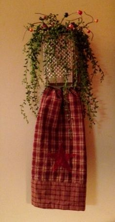 Cheese Grater towel holder. Store pot holders in top