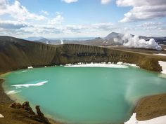 """Why we love it: Scientists have now confirmed Víti was naturally formed at the bottom of one of Askja's craters, but its name means """"hell,"""" owing to an earlier-held belief that large craters were the gates to the underworld. It's not just pretty to look at: Weather permitting, you can even take a swim in the warm, mineral-rich lake."""