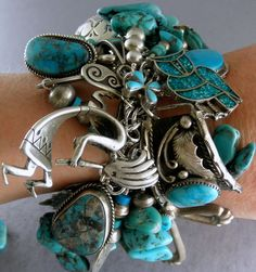 Oh my word, I love this 303 grams Spectacular 56 Charms Pawn Navajo Turquoise Charm Bracelet