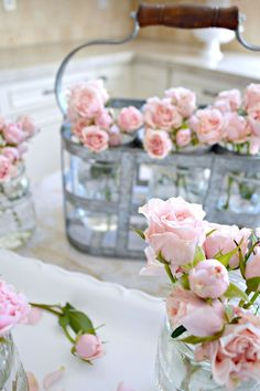 delicate roses displayed in a vintage caddy, so pretty