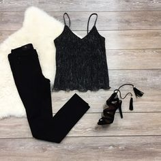 This black tank top is amazing! This top is lined with a sheer panel on top. This top has hints of gold and silver running through out and it looks great with black jeans and heels! Fit: - This item f