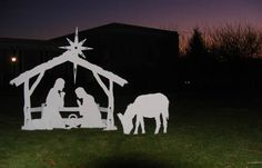 A beautiful Nativity Scene to show the true meaning of Christmas.  Carolyn adds a new figure every year.  Last year an Angel was added this year a Shepard and sheep - Lifesize makes a lovely Christmas display.