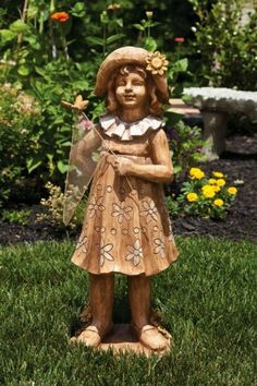 """25"""" Girl in Floral Dress with Butterfly Net Outdoor Patio Garden Statue by Evergreen. $114.99. Girl in Floral Dress with Butterfly Net StatueItem #842522This statue features a young girl in a floral print dress holding a butterfly netAccented with a butterfly on the netDimensions: 25""""H x 8.75""""W x 9""""DMaterial(s): man-made material"""