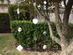Create a light show in your garden with an easy-to-make mirror garland.
