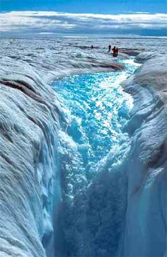 Greenland icesheets - As ice melts at the surface, water carves fissures and water tumbling down the huge moulin.