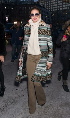 While the street-style peacocks strutted their outré ensembles for the cameras, one fashion figure returned a more serene palette and a sleeker silhouette.