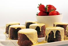 Chocolate fruit mince puddings with custard and strawberries, brought to you by Woolworths Christmas. Just Desserts, Delicious Desserts, Cooking Chocolate, Golden Syrup, Pudding Desserts, Mixed Fruit, Strawberry Recipes, Gourmet Recipes, Puddings