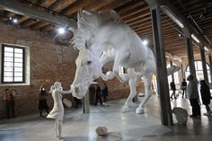 A Girl Encounters a Giant White Horse Frozen in Mid-Air Within the Venice Biennale's Argentinian Pavilion | Colossal